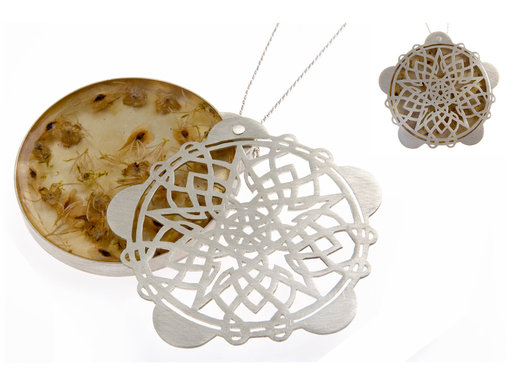 <p>sterling silver, found objects, resin</p>